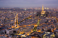 Eiffel Tower, night, from Tour Montparnasse, Paris, France (Blvd Garibaldi at left).  La Defense is on horizon, behind Eiffel Tower