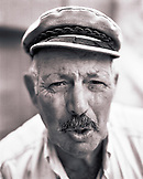 GREECE, Patmos, Diakofti, Dodecanese Island, portrait of Mihais Grillakis, the owner of Taverna Diakofti (B&W)