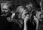 candid scene of emotional outpouring by group of school girls shot in black & white