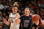 March 6, 2015; Las Vegas, NV, USA; Loyola Marymount Lions guard Makenzie Cast (32) dribbles the basketball against Gonzaga Bulldogs guard Elle Tinkle (31) during the second half of the WCC Basketball Championships at Orleans Arena.