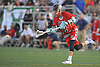Kevin Winkoff #28 of Cold Spring Harbor scores a goal during the fourth quarter of the Nassau County varsity boys lacrosse Class C final against Locust Valley at Hofstra University on Tuesday, May 31, 2016. Cold Spring Harbor won by a score of 17-9.