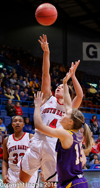 SIOUX FALLS, SD - MARCH 9:  Tia Hemiller #4 of USD shotos over Rebecca Henricson #15 of Western Illinois during their quarterfinal game at the 2014 Summit League Basketball Championships at the Sioux Falls Arena Sunday.  Polly Harrington #33 of USD is in the background. (Photo by Dick Carlson/Inertia)