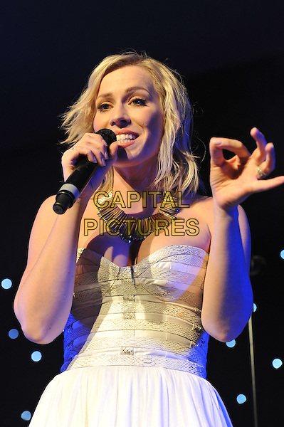 Natasha Bedingfield.'Global Angels Awards', The Park Plaza Hotel, Westminster, London, England. 2nd December 2011..music on stage live concert gig performing half length microphone singing strapless white dress hand .CAP/MAR.© Martin Harris/Capital Pictures.