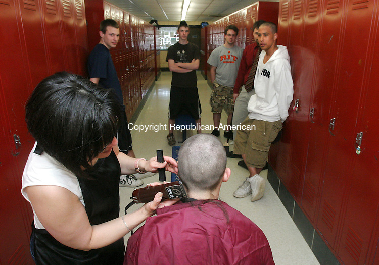 WOODBURY, CT 4/23/07- 042307BZ18- Sue Meyer, of Stepping Out on Main Street in Woodbury, shaves the head of Nonnewaug High School sophmore Nick Bennett, 17, of Woodbury, as his friends (from left) Mike Mastroianni, 15, gr. 10, of Woodbury, Casey Allen, 16, gr. 10, of Bethlehem, Brian Ernst, 18, gr. 12, of Woodbury, U.S. History teacher Mike Sturges, and Mike Dixon, 16, gr. 10, of Oxford, look on Monday afternoon.  They were taking part in a Student Council sponsored &quot;The Bald and the Beautiful&quot; program to raise $4,250 overalll for four families within the Region 14 school district that have members suffering from cancer.  Students and teachers have volunteered to have their heads shaved after a certain money goal is reached.<br /> Jamison C. Bazinet Republican-American