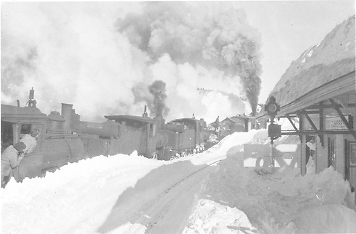 Rotary snowplow pushed by at least three engines clearing snow at Cumbres station.<br /> D&amp;RGW  Cumbres, CO