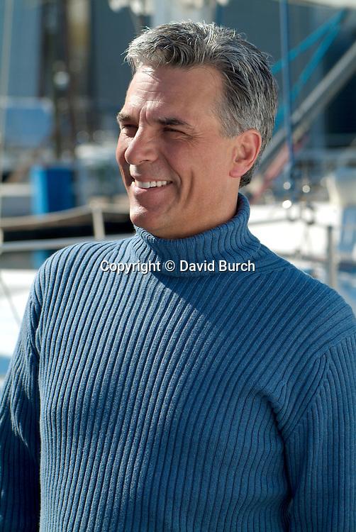 Man at marina smiling