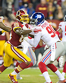 New York Giants defensive end Jason Pierre-Paul (90) is blocked by Washington Redskins tight end Vernon Davis (85) in first quarter action at FedEx Field in Landover, Maryland on Thursday, November 23, 2017.<br /> Credit: Ron Sachs / CNP<br /> (RESTRICTION: NO New York or New Jersey Newspapers or newspapers within a 75 mile radius of New York City)