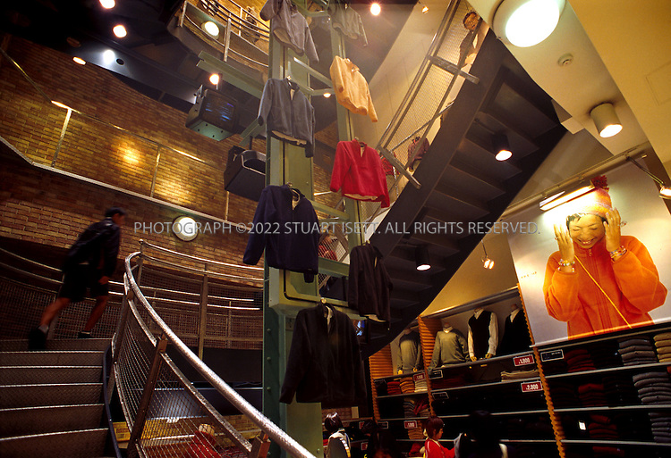 10/20/2001--Tokyo, Japan..UNIQLO, the discount Japanese clothing retailer's Harajuku shop in Tokyo...All photographs ©2003 Stuart Isett.All rights reserved.This image may not be reproduced without expressed written permission from Stuart Isett.