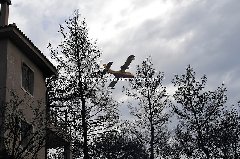 Pictured: A fire service aeroplane in the aftermath of the wild forest fires in the Neos Voutzas area near Rafina, Greece. Tuesday 24 July 2018<br /> Re: Deaths caused by wild forest fires throughout Greece.