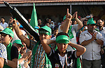 Palestinians who support the Islamic Hamas movement hold a rally showing their support and solidarity with Hamas in the West Bank city of Tulkarem, 30 August 2014. An indefinite ceasefire to end seven weeks of fighting between Israel and Palestinian militant groups in the Gaza Strip was holding with Hamas declaring 'victory' and the Israeli cabinet divided on the deal. Egypt, which brokered the deal, has said that indirect talks between the two sides would resume within a month. More than 2,130 Palestinians and 70 Israelis, mainly soldiers, have been killed in 50 days of fighting. Photo by Nedal Eshtayah