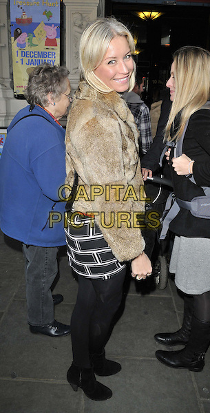 """Denise Van Outen.attended the """"Peppa Pig's Treasure Hunt"""" press night,  Criterion theatre, Piccadilly, Piccadilly Circus, London, England, 2nd December 2011..full length  smiling black beige fur jacket tights dress  ankle boots side .CAP/CAN.©Can Nguyen/Capital Pictures."""