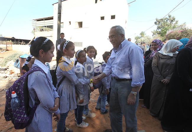 Palestinian Prime Minister Salam Fayyad visits the village of Ezbet al-Tabib in the West Bank city of Qalqilya,11 October 2012. Photo by Mustafa Abu Dayeh
