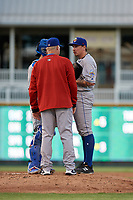 Amarillo Sod Poodles pitching coach Jimmy Jones talks with pitcher Lake Bachar (33) and catcher Luis Torrens (21) during a Texas League game against the Frisco RoughRiders on May 16, 2019 at Dr Pepper Ballpark in Frisco, Texas.  (Mike Augustin/Four Seam Images)