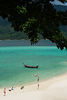 Ko Lipe Sunrise beach (Bulow beach) with beach-goers and a boat, Thailand