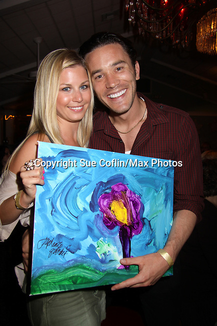 Guiding Light Tom Pelphrey bought Stephanie Gatschet's Painting at A Night of Stars on May 14 at Bistro Soleil, Olde Marco Inn, Marco Island, Florida - SWFL Soapfest Charity Weekend May 14 & !5, 2011 benefitting several children's charities including the Eimerman Center providing educational & outfeach services for children for autism. see www.autismspeaks.org. (Photo by Sue Coflin/Max Photos)
