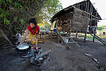 Chan Ran cooks a meal in the village of Thmar Dat in northern Cambodia. Following devastating 2011 floods in the village, Church World Service and Dan Church Aid, both members of the ACT Alliance, helped villagers to recover their homes and livelihoods.