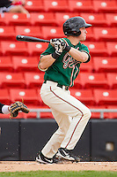 Aaron Dudley #17 of the Greensboro Grasshoppers follows through on his swing against the Hickory Crawdads at L.P. Frans Stadium on May 18, 2011 in Hickory, North Carolina.   Photo by Brian Westerholt / Four Seam Images