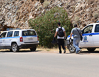 Pictured: Emergency services personnel in Ikaria, Greece. Thursday 08 August 2019<br /> Re: Rescuers searching for  British scientist Natalie Christopher, 35, who disappeared on the  island of Ikaria, Greece have found her body at the bottom of a ravine.<br /> She was found less than a mile from the hotel in the Kerame area where she was on holiday with her Cypriot partner.<br /> Emergency service staff said that a large rock had dislodged as she fell, causing multiple head injuries.<br /> The woman's body will be kept overnight at the spot so a coroner can examine it on Thursday morning.