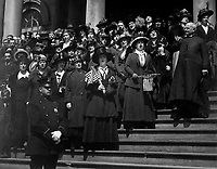 "Members of the ""Liberty Loan Choir"" singing on the steps of City Hall, New York City, in the third Liberty Loan campaign.  At the right is Bishop William Wilkinson, who led the choir.  April 1918.  Paul Thompson.  (Army)<br />