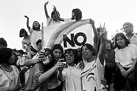 Celebraciones del triunfo del NO a Pinochet en el plebiscito 1988.<br /> Santiago Chile 7 Octubre 1988<br /> <br /> Forty years ago, on September 11, 1973, a military coup led by General Augusto Pinochet toppled the democratic socialist government of Chile. President Salvador Allende was killed during the  attack to seize  La Moneda presidential palace.  In the aftermath of the coup, a quarter of a million people were detained for their political beliefs, 3000 were killed or disappeared and many thousands were tortured.<br /> Some years later in 1981, while Pinochet ruled Chile with iron fist, a young photographer called Juan Carlos Caceres started to freelance in the streets of Santiago and the poblaciones or poor outskirts, showing the growing resistance against the dictatorship. For the next 10 years Caceres photographed every single protest and social movement fighting for the restoration of democracy. He knew that his camera was his only weapon, he knew that his fate was to register the daily violence and leave his images for the History.<br /> In this days Caceres is working to rescue and organize his collection of images in the project Imagenes de la Resistencia   . With support of some Chilean official institutions, thousands of negatives are digitalized and organized to set up the more complete visual heritage of this  violent period of Chile´s history.
