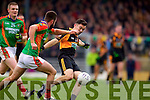 Pat McCarthy Austin Stacks in action against  Danny O'Sullivan  Mid Kerry in the Kerry Senior County Football Final at Fitzgerald Stadium on Sunday.