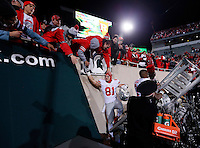 Ohio State Buckeyes tight end Nick Vannett (81) gets high fives from fans following the 49-37 win over Michigan State in the NCAA football game at Spartan Stadium in East Lansing, Michigan on Nov. 8, 2014. (Adam Cairns / The Columbus Dispatch)