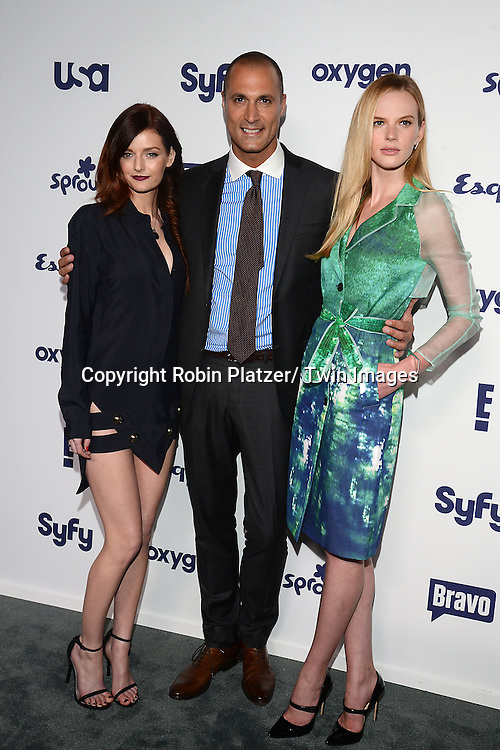 Lydia Hearst Nigel Barker and Anne V in NoNoo green dress attends the NBCUniversal Cable Entertainment Upfront <br /> on May 15, 2014 at The Javits Center North Hall in New York City, New York, USA.