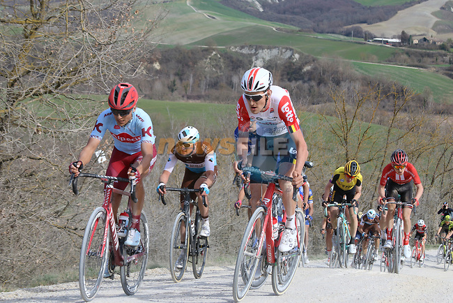 The peloton including Tiesj Benoot (BEL) Lotto-Soudal and Ruben Guerreiro (POR) Team Katusha Alpecin give chase on sector 8 Monte Santa Maria during Strade Bianche 2019 running 184km from Siena to Siena, held over the white gravel roads of Tuscany, Italy. 9th March 2019.<br /> Picture: Seamus Yore | Cyclefile<br /> <br /> <br /> All photos usage must carry mandatory copyright credit (© Cyclefile | Seamus Yore)