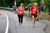 Chelanman's competitors know no age barriers. These twoolder  women, competiting it two different events at the annual multi-sport weekend were nearing the finish.The Saturday events include a long course Triathlon, a 10K run and a Half Marathon and an Olympic Triathlon.