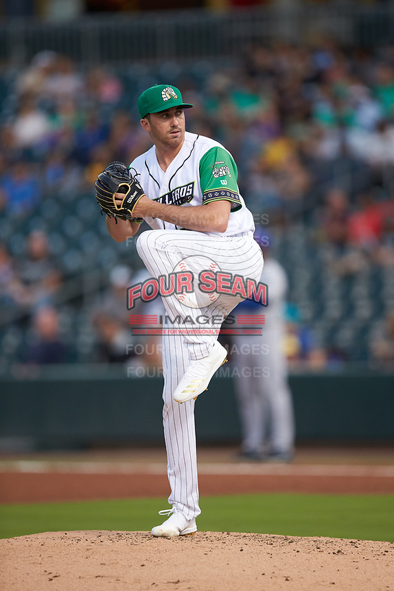 Caballeros de Charlotte relief pitcher Zach Thompson (32) in action against the Buffalo Bisons at BB&T BallPark on July 23, 2019 in Charlotte, North Carolina. The Bisons defeated the Caballeros 8-1. (Brian Westerholt/Four Seam Images)
