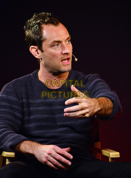 Jude Law.discusses his latest film 'Side Effects' at Apple Store, 235 Regent Street, London, England..February 27th, 2013.half length  blue grey gray striped stripes sweater jumper top hand arm funny mouth open stubble facial hair  .CAP/BF.©Bob Fidgeon/Capital Pictures.