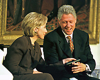 ***FILE PHOTO*** Bill Clinton Has Not Apologized To Monica Lewinsky And Claims Did The Right Thing Staying In Office.<br /> <br /> United States President Bill Clinton and first lady Hillary Rodham Clinton share a light moment during the live broadcast of the &quot;Millennium Evening Lecture Series from the East Room of The White House in Washington, DC on 18 September, 1998.<br /> CAP/MPI/RS<br /> &copy;RS/MPI/Capital Pictures