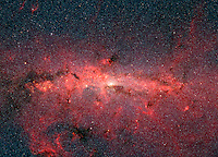 This dazzling infrared image from NASA, shows hundreds of thousands of stars crowded into the swirling core of our spiral Milky Way galaxy. In visible-light pictures, this region cannot be seen at all because dust lying between Earth and the galactic center blocks our view.?The region pictured here is immense, with a horizontal span of 890 light-years and a vertical span of 640 light-years. Earth is located 26,000 light-years away, out in one of the Milky Way's spiral arms. Though most of the objects seen in this image are located at the galactic center, the features above and below the galactic plane tend to lie closer to Earth.