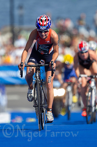 24 AUG 2013 - STOCKHOLM, SWE - Rachel Klamer (NED) of the Netherlands  climbs a hill during the bike at the elite women's ITU 2013 World Triathlon Series round in Gamla Stan in Stockholm, Sweden (PHOTO COPYRIGHT © 2013 NIGEL FARROW, ALL RIGHTS RESERVED)