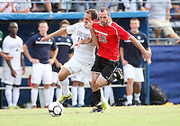 Jose Colchao #11 of Georgetown University battles for the ball with Brendan Ennis #15 of Northeastern University during an NCAA match at North Kehoe Field, Georgetown University on September 3 2010 in Washington D.C. Georgetown won 2-1 AET.