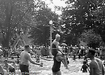 "South Park PA: View of second slide and people having fun at the South Park Swimming pool - 1931. The philosophy of recreation in the '20s and '30s was different than it is today. The differences between the haves and the have-nots of society was understood differently, and the county parks were called ""the people's country clubs,"" bringing to poorer people the same recreation that the wealthy paid for at private clubs: golf, tennis, swimming, picnicking. The parks offered common folk the chance to escape to rural campgrounds, day camps, and ""retreats."" Certain modern recreational concepts had not yet arrived: people didn't ""swim,"" they ""bathed""; hence, a large South Park pool was only four feet deep at its deepest point."