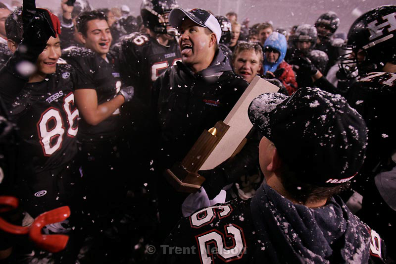 Trent Nelson  |  The Salt Lake Tribune.Hurricane head coach Chris Homer holds the championship trophy after his team defeated Desert Hills 21-0 in the 3A State Championship high school football game at Rice-Eccles Stadium in Salt Lake City, Utah, Friday, November 18, 2011.