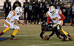 WATERBURY, CT-112117JS18- WCA's Matt Torres (1) dives on a loose ball before Gilbert-Northwestern's Brad Lissy (6) and Liam Duran (50) during their game Tuesday at Municipal Stadium in Waterbury. <br /> Jim Shannon Republican-American