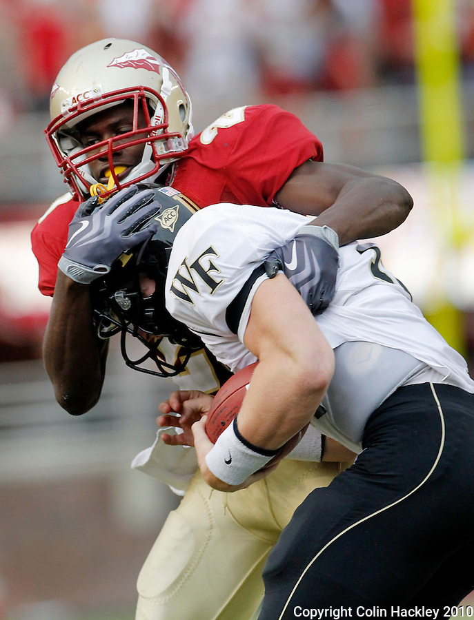 TALLAHASSEE, FL 9/25/10-FSU-WF FB10 CH-Florida State's Lamarcus Joyner tackles Wake Forest's Tanner Price during second half action Saturday at Doak Campbell Stadium in Tallahassee. The Seminoles beat the Demon Deacons 31-0..COLIN HACKLEY PHOTO