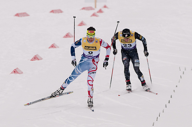 HOLMENKOLLEN, OSLO, NORWAY - March 15: (L-R) Jason Lamy Chappuis of France (FRA) and Taylor Fletcher of USA during the cross country 10 km (4 x 2.5 km) competition at the FIS Nordic Combined World Cup on March 15, 2013 in Oslo, Norway.  1st place Eric Frenzel of Germany (GER), 2nd place Akito Watabe of Japan (JPN) and 3rd place Yoshito Watabe of Japan (JPN). (Photo by Dirk Markgraf)