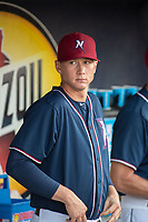 Northwest Arkansas Naturals pitcher Brady Singer (29) watches from the dugout during a Texas League game between the Northwest Arkansas Naturals and the Arkansas Travelers on May 30, 2019 at Arvest Ballpark in Springdale, Arkansas. (Jason Ivester/Four Seam Images)