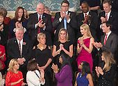 Carryn Owens (black dress), the widow of William &quot;Ryan&quot; Owens, a Navy SEAL killed in the Trump administration's first counterterrorism operation in Yemen is acknowledged by U.S. President Donald J. Trump during his address to a joint session of Congress on Capitol Hill in Washington, DC, February 28, 2017. <br /> Credit: Chris Kleponis / CNP