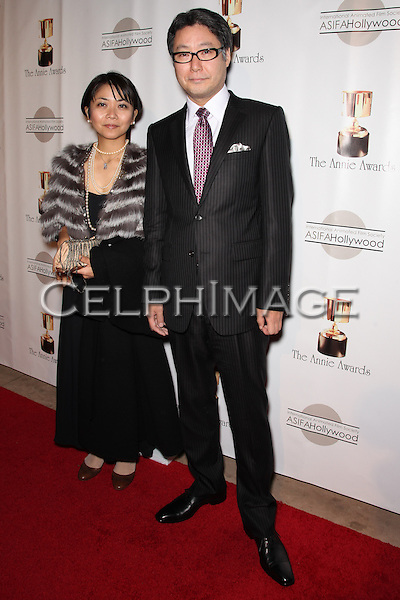 TADAHIRO UESUGI, HIROKO UESUGI. Red Carpet arrivals to the 37th Annual Annie Awards Gala at Royce Hall on the UCLA campus. Los Angeles, CA, USA. February 6, 2010.