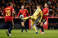 18th November 2019; Wanda Metropolitano Stadium, Madrid, Spain; European Championships 2020 Qualifier, Spain versus Romania;  Ianis Hagi (Romania)  controls the ball surrounded by Busquets, Carzola and Ruiz of Spain - Editorial Use