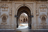"Near the desert town of Bikaner is  Deshnoke, here you find the temple of the Gajner Palace. 30 Km from Bikaner, the 600 -year old temple is dedicated to Karni Mata. .It plays host to thousands of rats. The rats are considered sacred and worshipped. .Karni Mata, born in the 14th century, was an incarnation of Durga, the goddess of power and victory. During her lifetime she performed many miracles.. Near the town of Bikaner is Deshnoke, you find the temple of the Gajner Palace. 30 Km from Bikaner, the 600 -year old temple is dedicated to Karni Mata.<br /> It plays host to thousands of rats. The rats are considered sacred and worshipped.<br /> The temple has huge intricately silver gates donated by Maharaja Ganga Singh.<br /> <br /> Rats running all over the place, every corner and niche was crawling with them.<br /> Temple priests tend to the rats by constantly refilling large bowls of milk and in the heart of the temple, the shrine, there is a huge bowl filled with Prasad (sugar balls). <br /> It is also highly likely, if not a certainty, that a ""holy rat"" will run over your feet, if so, it is considered a blessing.<br /> If a white rat is sighted then you are especially spiritually graced. Eating food or drinking water that previously has been sampled by a rat is considered to be a supreme blessing"