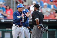Durham Bulls manager Charlie Montoyo #25 argues a call with umpire Kelvin Bultron during a game against the Buffalo Bisons on June 24, 2013 at Coca-Cola Field in Buffalo, New York.  Durham defeated Buffalo 7-1.  (Mike Janes/Four Seam Images)