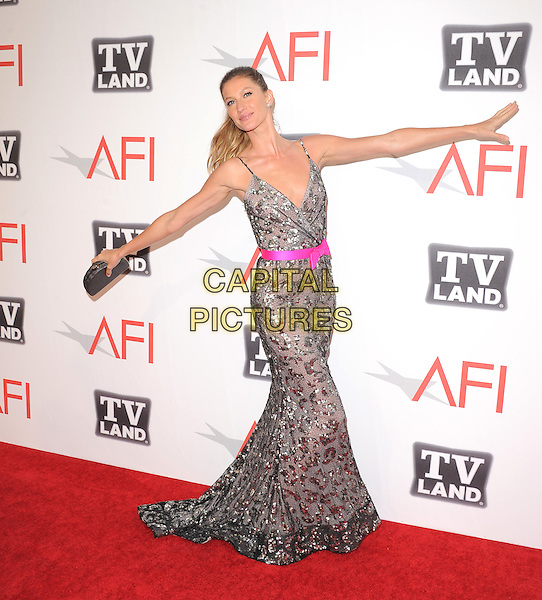 Gisele Bundchen.at TV Land's 2011 AFI Lifetime AChievement Award Honoring Morgan Freeman held at Sony Picture Studios in Culver City, California, USA, .June 9th 2011..full length dress pink belt  long maxi  silver beaded grey gray straps bow clutch bag sequined sequin funny arms outstretched .CAP/RKE/DVS.©DVS/RockinExposures/Capital Pictures.
