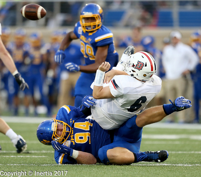 BROOKINGS, SD - AUGUST 31: Kellen Soulek #94 from South Dakota State University brings down Tommy Stuart #6 from Duquesne as he attempts a pass in the first half of their game Thursday night at Dana J. Dykhouse Stadium in Brookings. Stuart was flagged for intentional grounding on the play. (Photo by Dave Eggen/Inertia)