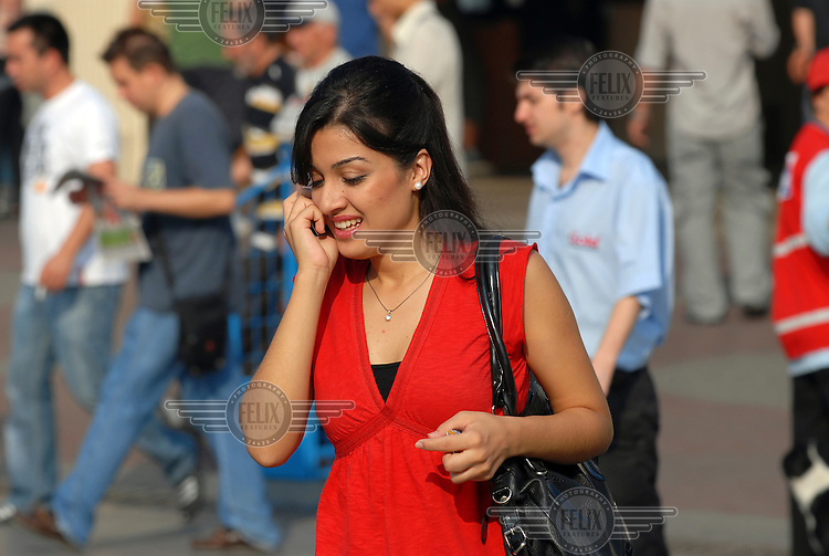 Woman talking on a mobile phone in central Istanbul.