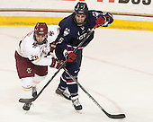 Austin Cangelosi (BC - 26), Jacob Poe (UConn - 5) - The Boston College Eagles defeated the visiting University of Connecticut Huskies 3-2 on Saturday, January 24, 2015, at Kelley Rink in Conte Forum in Chestnut Hill, Massachusetts.